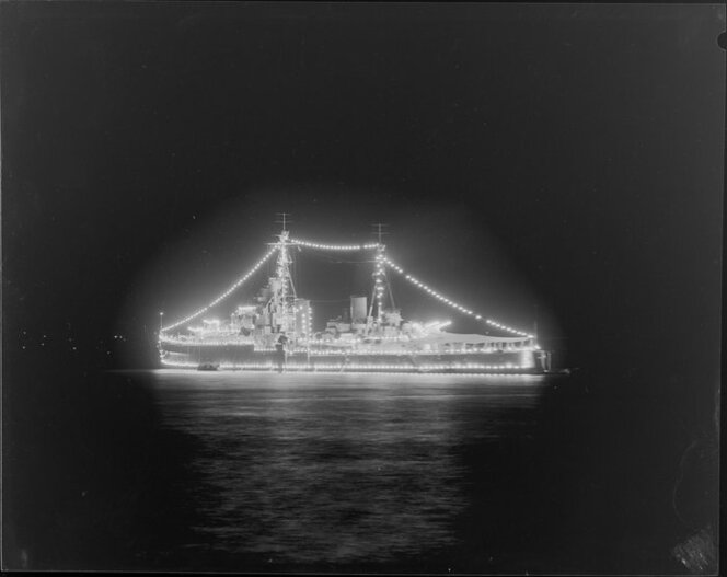 HMNZS Bellona lit up for the 100th Auckland Anniversary Regatta in 1950.